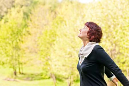 mature woman breathing in the fresh outdoor air
