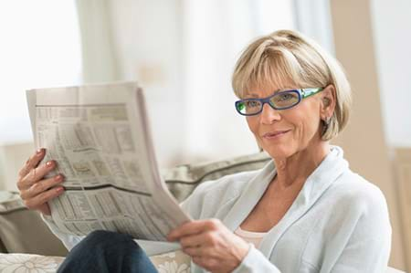 mature woman reading new research on menopause symptoms