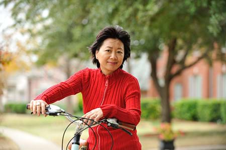 middle aged woman sitting on bike